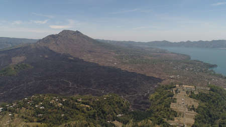 Aerial view landscape after volcanic eruption volcano Batur mountain landscape with volcano sky and clouds Bali, Indonesia. Travel concept. Standard-Bild - 115258475