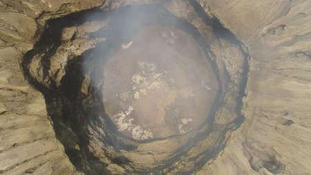 smoking crater active volcano Bromo. aerial view mountain landscape volcano crater and mountains Tengger Semeru national park Java, Indonesia. Standard-Bild - 115258501