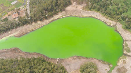 volcanic sulfur lake telaga warna in dieng plateau, java Indonesia. mountain tropical landscape lake with green water among mountains. this lake is one mainstay tourist destinations in Wonosobo Regency Standard-Bild - 115258606