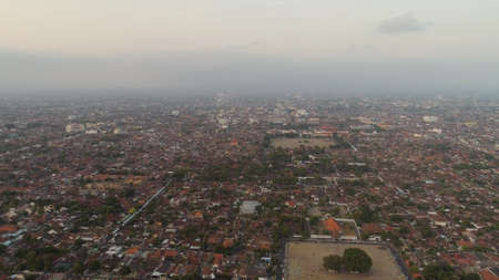 cityscape Yogyakarta with buildings, highway at sunset time. aerial view cultural capital Indonesia yogyakarta located on java island, Indonesia Standard-Bild - 115258607