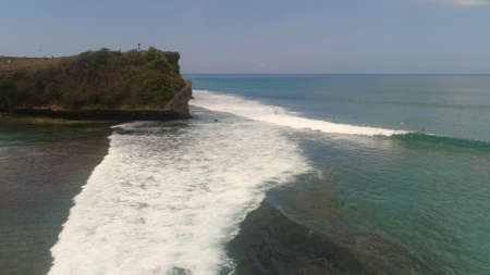 aerial view surfers on water surface ocean catch wave. People learning to surf bali, indonesia Standard-Bild - 115259707