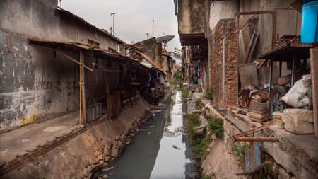 Poor area with slums and sewers in Indonesia. Poor asian city block