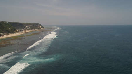Aerial view coast with sandy tropical beach. seascape ocean surf and tropical beach large waves turquoise water crushing on beach Melasti, Bali,Indonesia. Travel concept. Stock Photo
