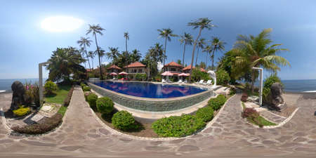 vr 360 swimming pool in luxury hotel with sun beds by sea. tropical resort with pool. Travel concept.