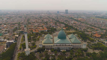 aerial view mosque in Indonesia Al Akbar in Surabaya, Indonesia. beautiful mosque with minarets on island Java Indonesia. mosque in an asian city