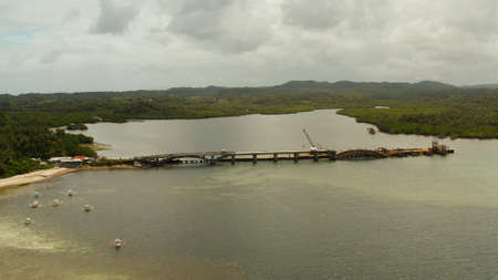 Bridge under construction over the sea bay connecting the two parts of Siargao island.