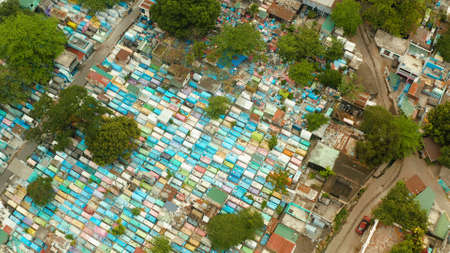 The northern cemetery in Manila from above, a tourist place where local poor people live among the graves. Travel concept. Stock Photo