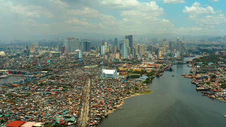 Manila city with skyscrapers, modern buildings and Makati business center, aerial drone. Travel vacation concept.