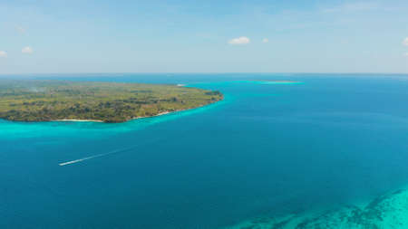 Tropical islands with coral reefs in the blue water of the sea, aerial view. Balabac, Palawan, Philippines. Summer and travel vacation concept.