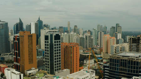 Cityscape of Makati, the business center of Manila. Asian metropolis with skyscrapers view from above. Travel vacation concept.