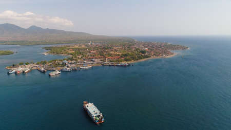 Aerial view ferry port gilimanuk with ferry boats, vehicles. Ferries transport vehicles and passengers in port. Port for departure from Bali to the island of Java. Stock fotó