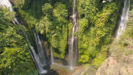 waterfall in green rainforest. Aerial view triple tropical waterfall Sekumpul in mountain jungle. Bali,Indonesia. Travel concept.
