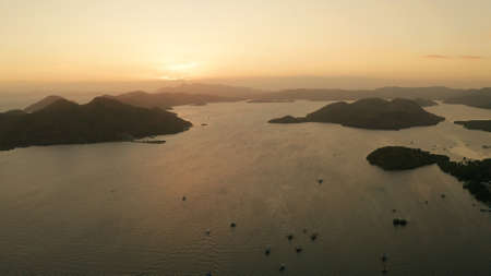 aerial view Sea bay with boats at sunset. Sunset over the sea with islands. Philippine Islands in the evening. Busuanga, Palawan, Philippines Stock Photo