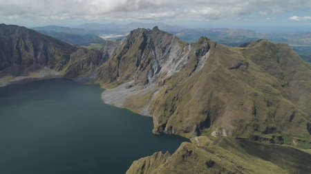 Crater lake of the volcano Pinatubo among the mountains, Philippines, Luzon. Aerial view beautiful landscape at Pinatubo mountain crater lake. Travel concept Stok Fotoğraf