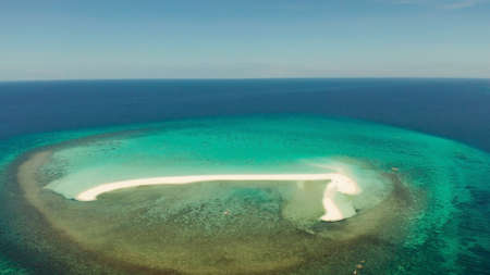 Tropical white island and sandy beach with tourists surrounded by coral reef and blue sea, aerial view. Sandbar Atoll. Island with sand bar and coral reef. Summer and travel vacation concept, Camiguin, Philippines. Stok Fotoğraf
