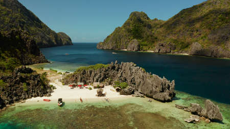 Tropical lagoon with sandy beach surrounded by cliffs, aerial view. El nido, Philippines, Palawan. Seascape with tropical rocky islands, ocean blue water. Summer and travel vacation concept Stok Fotoğraf