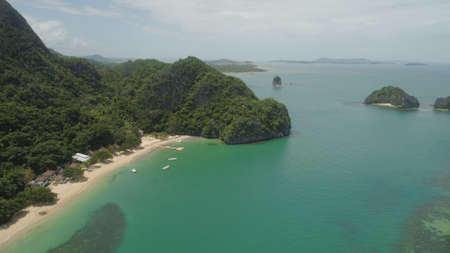 Aerial view islands with sand beach and turquoise water in blue lagoon among coral reefs, Caramoan Islands, Philippines. Landscape with sea, tropical beach. Stok Fotoğraf