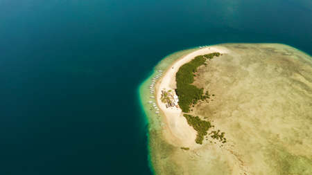 Tropical island and sandy beach with tourists surrounded by coral reef and blue sea in honda bay, aerial view. Island with sand bar and coral reef. starfish island. Summer and travel vacation concept, Philippines, Palawan Stok Fotoğraf