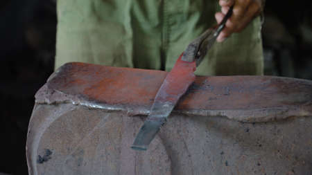 Hot metal is processed on the anvil in the forge. Anvil in the forge