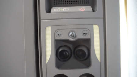 Overhead console of conditioner in a airplane. Fasten Seat belt. Symbol sign that be lighting for security on every flight trip