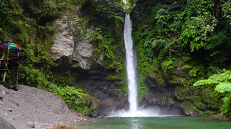 Beautiful waterfall in green forest. Tropical Tuasan Falls in mountain jungle. waterfall in the tropical forest. Camiguin, Philippines, Mindanao Stok Fotoğraf