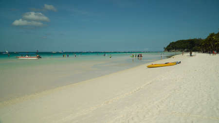 Tropical beach with tourists and clear blue sea. Summer and travel vacation concept. Boracay, Philippines