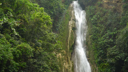 Beautiful waterfall in green forest. Tropical Mantayupan Falls in mountain jungle, Philippines, Cebu. Waterfall in the tropical forest.