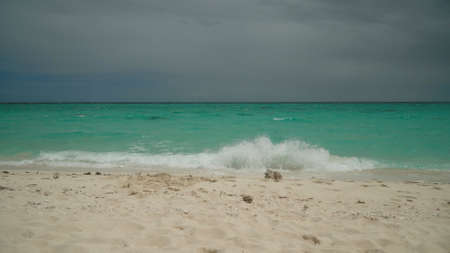 Sandy tropical beach and blue sea. Summer and travel vacation concept. Stok Fotoğraf