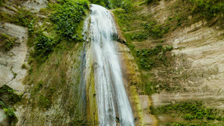 Dao waterfalls in a mountain gorge in the tropical jungle, Philippines, Cebu. Waterfall in the tropical forest.