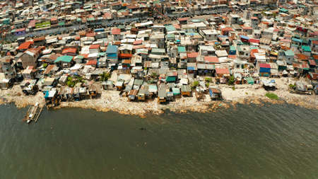Poor district and slums in Manila with shacks and buildings. Manila, Philippines. Stok Fotoğraf