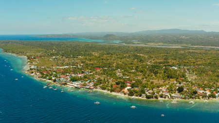 Coastline with coral reef and blue water, diving site, Moalboal, Philippines. Aerial view, Summer and travel vacation concept.