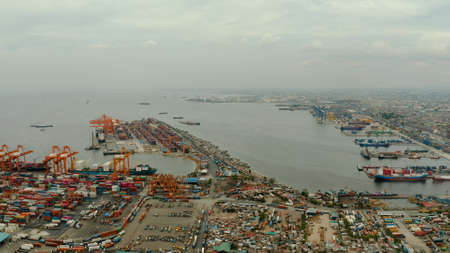 Sea port with container terminal top view in the city of Manila. Largest cargo port. modern harbor and global trade background ,Philippines.