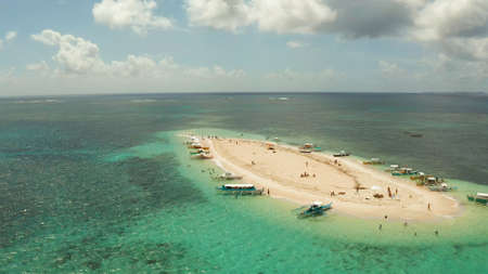 Sandy white island with beach and sandy bar in the turquoise atoll water, aerial drone. Tropical island and coral reef. Naked Island, Siargao. Stok Fotoğraf
