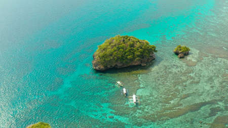 Clear turquoise water in a lagoon with rocky islands and corall reef from above Boracay, Philippines. Summer and travel vacation concept.