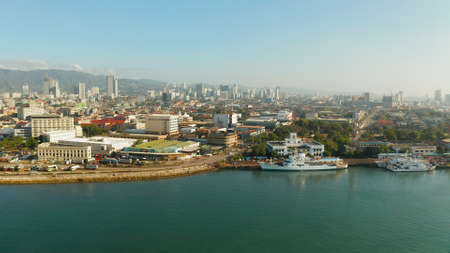 Cebu City, a major city on the island of Cebu, with skyscrapers and residential buildings in the early morning. Philippines. Stock Photo