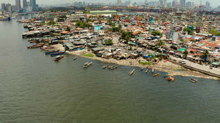 Manila is the capital of the Philippines with slums and poor district and skyscrapers and modern buildings.