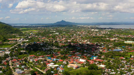 Tropical landscape with panorama of Tacloban, aerial view. Town and sky with cumulus clouds. Leyte Island, Philippines. . Summer and travel vacation concept.