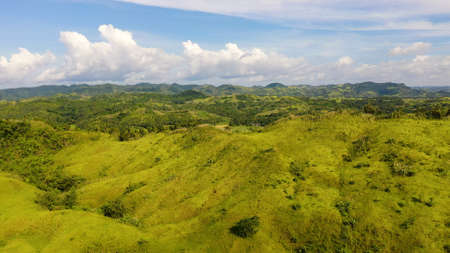 The nature of the Philippine Islands, Samar. Mountains and hills in clear weather. Tropical landscape with green hills and rice fields, aerial view. Summer and travel vacation concept.