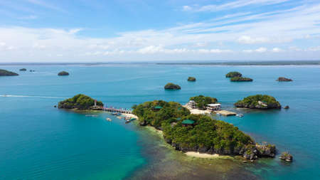 A group of small Islands with beaches and lagoons located in the hundred Islands national Park, Pangasinan, Philippines, top view. Summer and travel vacation concept