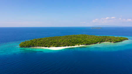 Perfect white sand beach on a tropical island. Mahaba Island, Philippines. Seascape with islands. Summer and travel vacation concept. Zdjęcie Seryjne