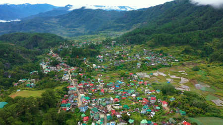 Typical houses of Sagada Mountain Province of the Philippines. The town is surrounded by mountains, a top view. Village in Cordillera mountains, Luzon, Philippines Zdjęcie Seryjne - 140510025