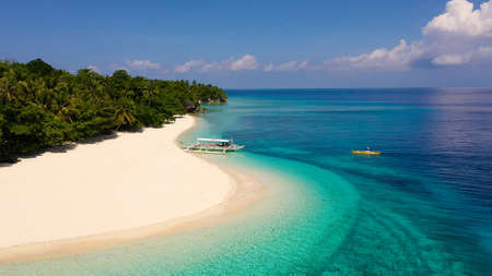 Seascape with a beautiful tropical island, aerial view. Mahaba Island, Philippines. Blue sea with turquoise lagoons. Summer and travel vacation concept. Zdjęcie Seryjne - 139028344