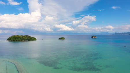 Seascape with tropical islands and coral reefs, aerial view. Caramoan Islands, Philippines. Summer and travel vacation concept. Stock Photo