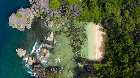 Beautiful tropical beach with tourists and boats, aerial drone. Lahos Island, Caramoan Islands, Philippines. Summer and travel vacation concept. Zdjęcie Seryjne
