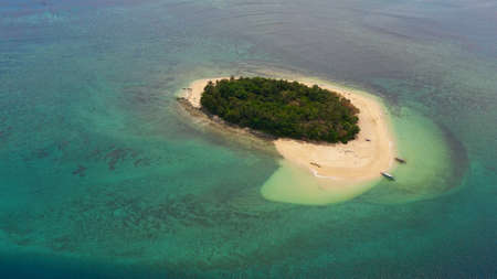 Aerial view of Tropical island with a sandy beach. Summer and travel vacation concept. Rosa island, Philippines. Zdjęcie Seryjne