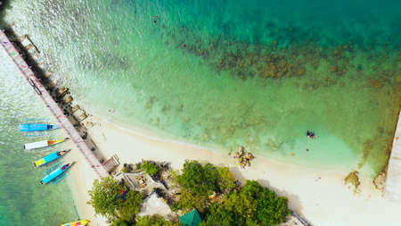 Aerial view: Tropical Island with a beautiful beach and vacationing tourists, tourist boats. Quezon Island Beach, Hundred Islands National Park, Pangasinan, Philippines. Alaminos. Summer and travel vacation concept Zdjęcie Seryjne