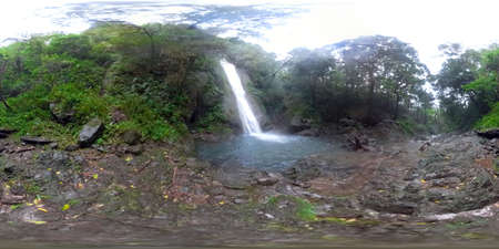 Beautiful waterfall in green forest 360VR. Tropical Kabigan Falls in mountain jungle. waterfall in the tropical forest. Luzon, Philippines. Zdjęcie Seryjne