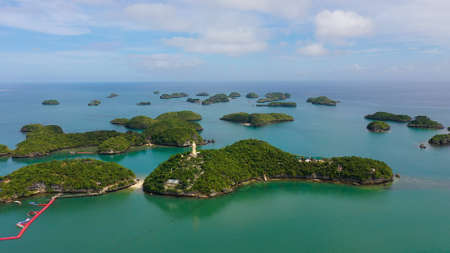 Cluster of small islands in Hundred Islands National Park, Pangasinan, Philippines. Aerial drone: Famous tourist attraction, Alaminos. Summer and travel vacation concept Zdjęcie Seryjne