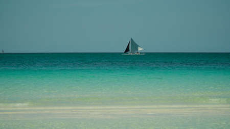 Sailing yacht in lagoon turquoise water, aerial view. Sailing boat glides over the waves, Summer and travel vacation concept