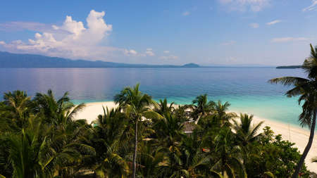 landscape of tropical island beach with perfect sky. Island with a tropical beach and turquoise lagoons. Digyo Island, Philippines. Summer vacation and tropical beach concept.